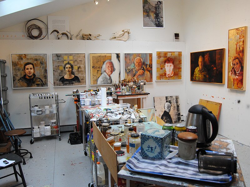 """Ordinary Saints"" adorn the walls of Bruce Herman's artist studio in Gloucester, Mass. RNS photo by G. Jeffrey MacDonald"