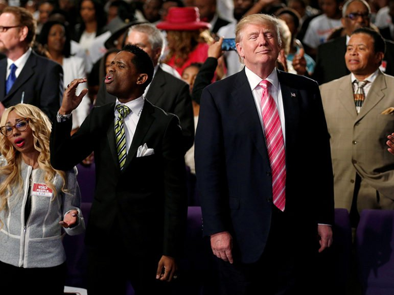 Republican presidential nominee Donald Trump attends a church service in Detroit on Sept. 3, 2016. Photo courtesy of Reuters/Carlo Allegri/
