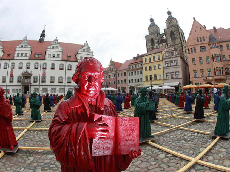 Plastic statuettes of 16th-century Protestant reformer Martin Luther, which are part of the art installation