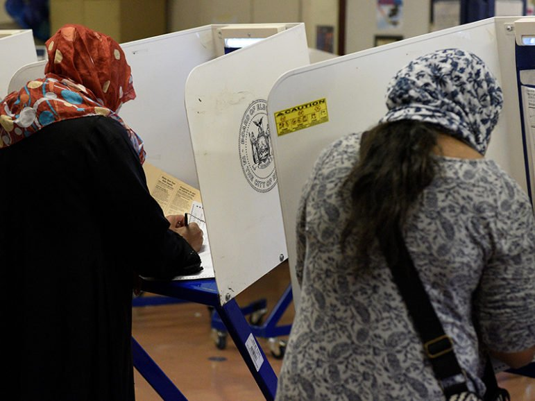 Muslim Bangladeshi Americans vote for the U.S. presidential election in the Queens borough of New York on Nov. 8, 2016. Photo courtesy of Reuters/Darren Ornitz  *Editors: This photo may only be republished with RNS-MUSLIM-VOTE, originally transmitted on Nov. 23, 2016.