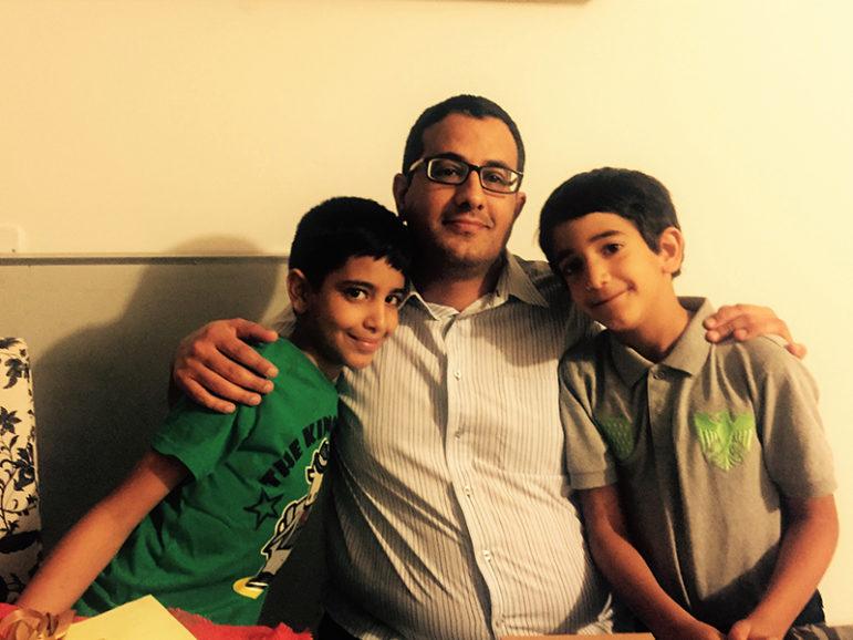Nadim al-Sakkaf with his two children before the arrest in August. Photo by Ruhiyeh Thabet al-Sakkaf