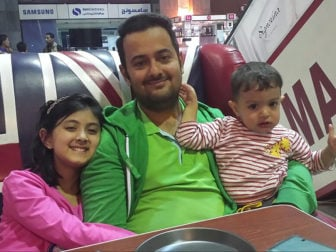 Naderal-Sakkaf with his two children before the arrest in August. Photo by Nafheh Sanai al-Sakkaf