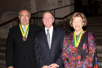 Fouad Makhzoumi, Brian Grim and Baroness Emma Nicholson stand together after the Makhzoumi and Nicholson received medals for their interfaith work. Grim presented Makhzoumi and Nicholoson awards on behalf of the Religious Freedom and Business Foundation and the United Nations Global Compact Business for Peace.