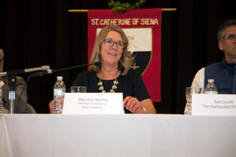 "L-R Western Connecticut State University Adjunct Professor MaryAnn Murtha offers insight during the ""Election Aftermath: Faith & the Common Good"" expert panel discussion, held on Dec. 7, 2016, at St. Catherine of Siena Parish, Riverside, Conn., in front of an audience of some 200 people. Tom Scott, business executive, Yale University Divinity School graduate student and CoFounder of the Greenwich, Conn.-based The Nantucket Project, listens in."