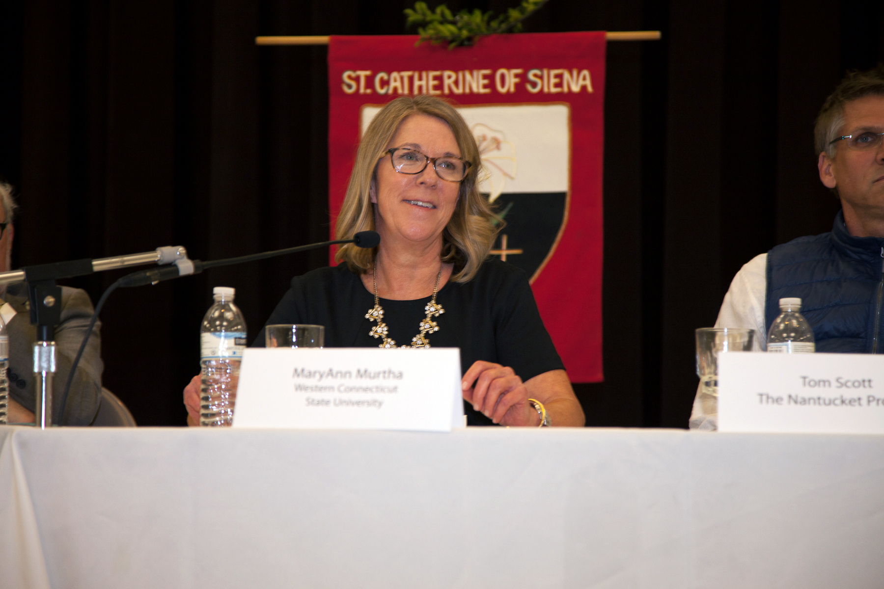 """L-R Western Connecticut State University Adjunct Professor MaryAnn Murtha offers insight during the """"Election Aftermath: Faith & the Common Good"""" expert panel discussion, held on Dec. 7, 2016, at St. Catherine of Siena Parish, Riverside, Conn., in front of an audience of some 200 people. Tom Scott, business executive, Yale University Divinity School graduate student and CoFounder of the Greenwich, Conn.-based The Nantucket Project, listens in."""