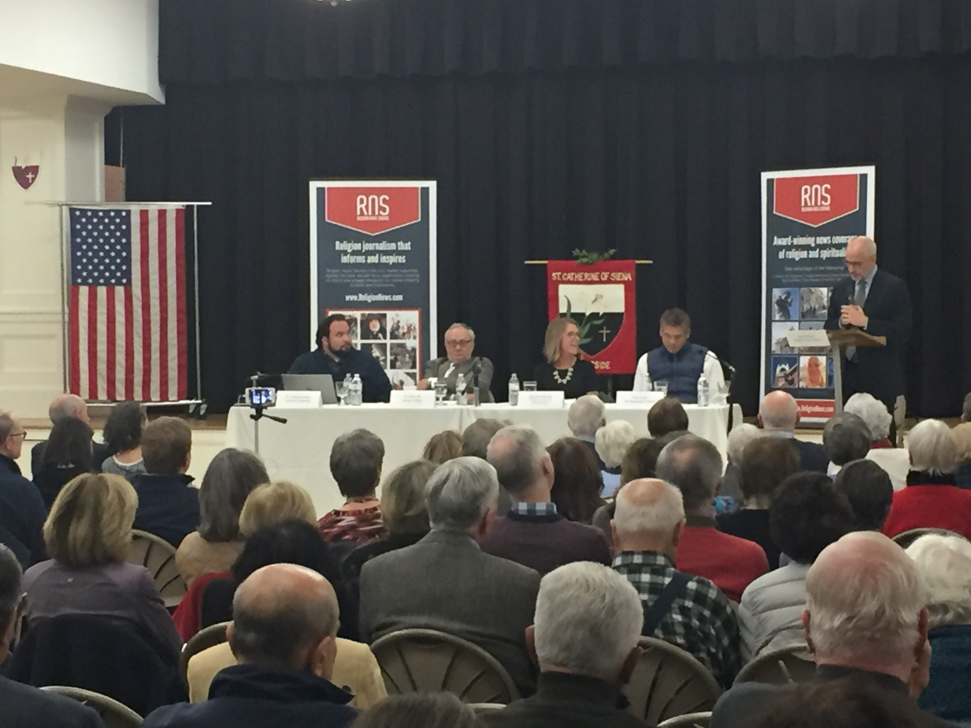 """RNS national reporter David Gibson introduces the expert panel titled, """"Election Aftermath: Faith & the Common Good, including (L-R) Dr. Charlie Camosy, Dr. Mark Silk, MaryAnn Murtha and Tom Scott, co-sponsored by the Religion News Service and St. Catherine of Siena Parish, Riverside, Conn."""