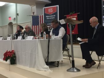On the far left Dr. Charlie Camosy offers his perspective on how to move the country forward following a brutal presidential campaign at an expert panel co-sponsored by Religion News Service and St. Catherine of Siena Parish, Riverside, Conn. Meanwhile, Dr. Mark Silk, MaryAnn Murtha, Tom Scott and David Gibson prepare to respond.