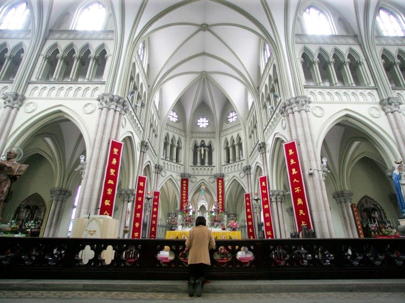 A Chinese Catholic prays
