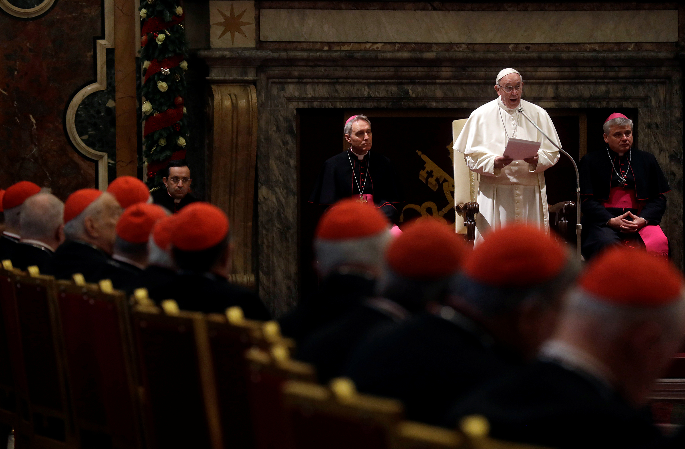PRINT Pope Francis speaks during the traditional greetings