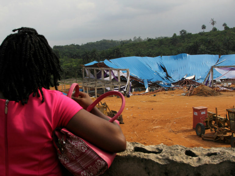A woman seeking her loved ones is seen at the venue of the collapsed church building in Uyo, Nigeria December 11, 2016. Photo via Reuters