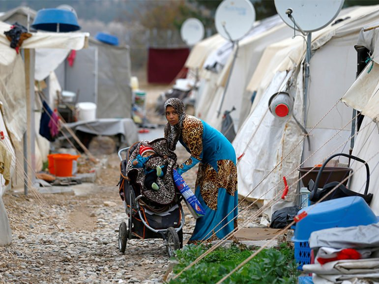 A Syrian refugee mother puts her baby to stroller in Nizip refugee camp, near the Turkish-Syrian border in Gaziantep province, Turkey, on Nov. 30, 2016. Photo courtesy of Reuters/Umit Bektas