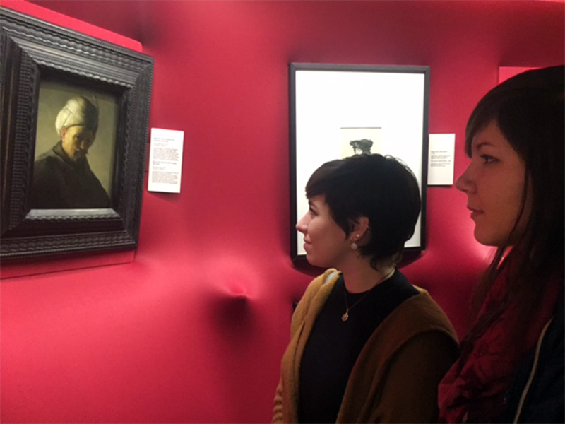 Alison Brittain, left, from Vancouver, WA, and Daisy Ignatova from Chicago, IL, explore the Rembrandt exhibition at the Vatican on Dec. 7, 2016. RNS photo by Josephine McKenna