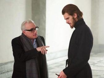 """Director Martin Scorsese, left, and actor Andrew Garfield talk on the set of """"Silence."""" Photo courtesy of Paramount Pictures"""