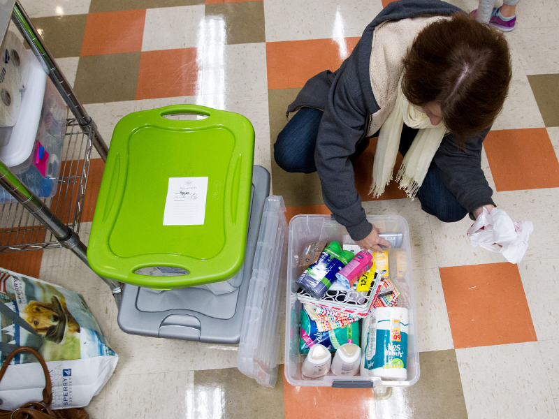 Melissa Maciejewski adds items to a hygiene kit for refugees at Lakeland Community Church in Lee's Summit, MO, on Dec. 11, 2016. The church will donate collected Welcome Kits to the World Relief office in Moline, IL, for distribution in Illinois and Iowa. RNS photo by Kit Doyle