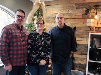 (Left to right) Executive Pastor Dave Davis, Discipleship Pastor Kim Whetstone and Senior Pastor Ray Kollbocker stand inside the Freedom Store at Parkview Community Church in Glen Ellyn, IL, on Dec. 9, 2016. The store -- selling items from Sari Bari, The Loyalty Workshop, The Re:New Project and Preemptive Love Coalition -- supports Parkview's Reclaiming Christmas message series and giving initiative focused on refugees. RNS photo by Emily McFarlan Miller