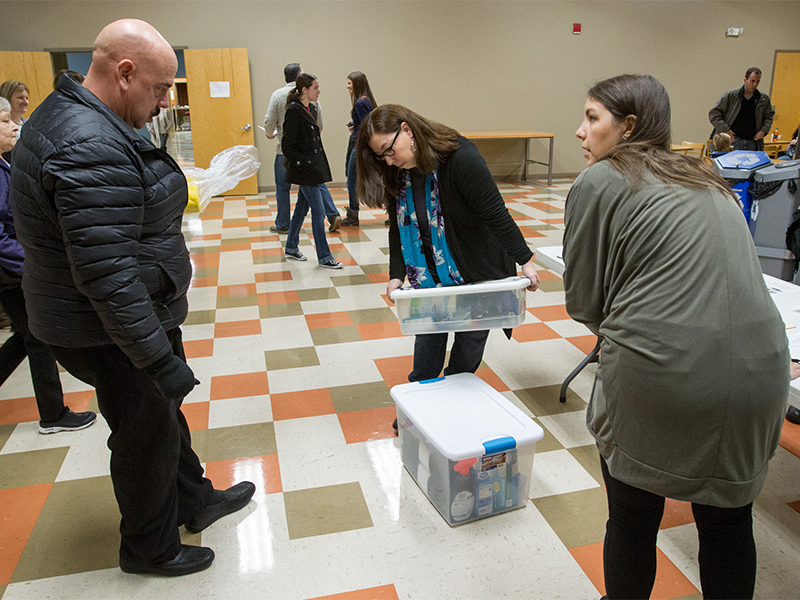 Pastor Marta Gilliland, center, and Becky Conrad, right, check the refugee Welcome Kits donated by Charles Brooks at Lakeland Community Church in Lee's Summit, MO, on Dec. 11, 2016. RNS photo by Kit Doyle