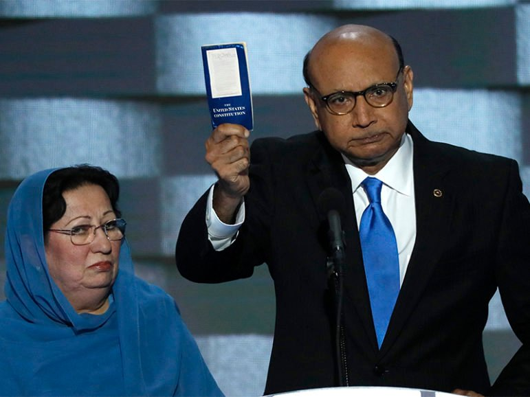 Khizr Khan, right, with wife Ghazala Khan, whose son Humayun S. M. Khan died serving in the U.S. Army, offers to loan his copy of the Constitution to Republican U.S. presidential nominee Donald Trump during the last night of the Democratic National Convention in Philadelphia, PA, on July 28, 2016. Photo courtesy of Reuters/Mike Segar