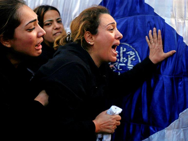 Egyptian Christians react during the funeral of victims killed in the bombing at Cairo's Coptic cathedral at the Mokattam Cemetery in Cairo on Dec. 12, 2016. Photo courtesy of Reuters/Amr Abdallah Dalsh