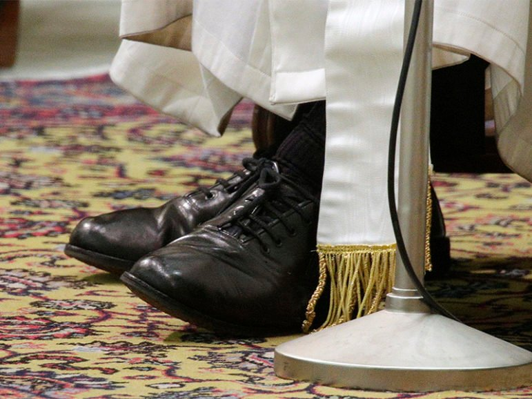 The shoes of Pope Francis are seen as he conducts a general audience in the Paul VI Hall at the Vatican on March 16, 2013.  Photo courtesy of Reuters/Max Rossi