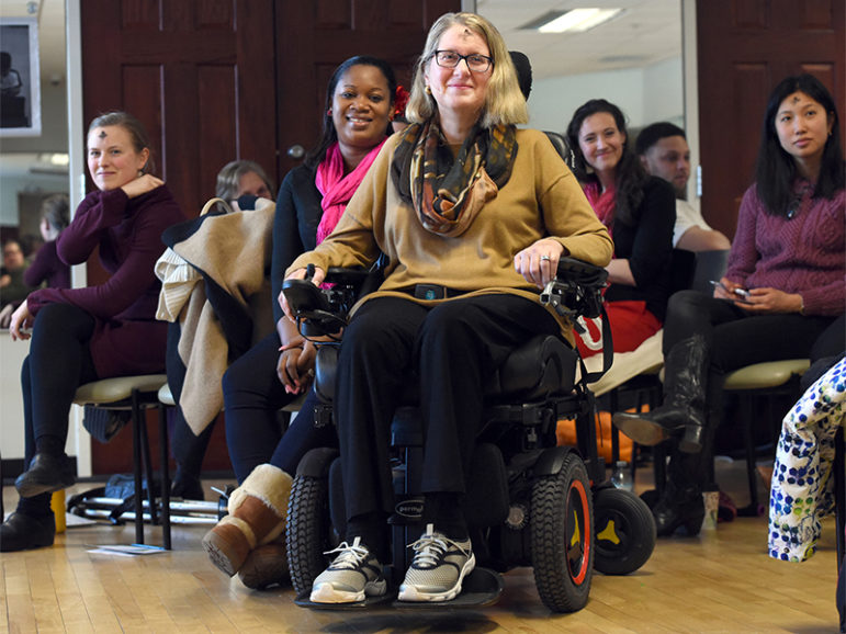 Amyotrophic Lateral Sclerosis (ALS) forced Rev. Nancy Butler, center, to step down as pastor of the Riverfront Family Church in Glastonbury, CT, during the service on Feb. 14, 2016.  Butler died on Dec. 7, 2016.  Photo courtesy of Mara Lavitt via the Hartford Courant
