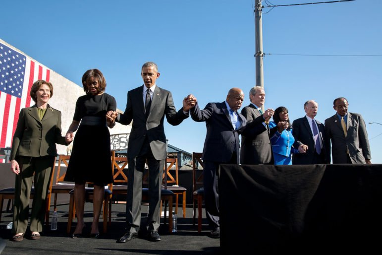 President Barack Obama and First Lady Michelle Obama join former First Lady Laura Bush, Rep. John Lewis, D-Ga., and former President George W. Bush for a prayer during the event to commemorate the 50th Anniversary of Bloody Sunday and the Selma to Montgomery civil rights marches, at the Edmund Pettus Bridge in Selma, Ala., on March 7, 2015. Photo courtesy of The White House/Pete Souza