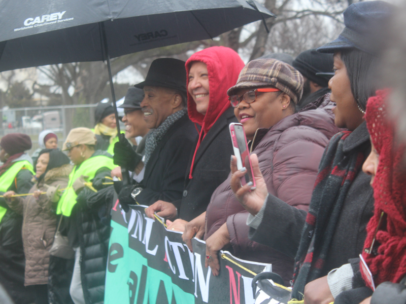 """The Rev. Al Sharpton, center, founder of the National Action Network, joins other civil rights leaders at the front of the """"We Shall Not Be Moved"""" march in Washington, D.C., on Jan. 14, 2017, ahead of the Martin Luther King Jr. Day. He was joined by, to his left, Urban League President Marc Morial and Melanie Campbell, president of the National Coalition on Black Civic Participation. RNS photo by Adelle M. Banks"""