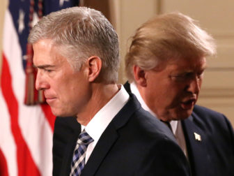 President Donald Trump steps back as Neil Gorsuch (L) approaches the podium to speak after being nominated to be an associate justice of the U.S. Supreme Court at the White House in Washington, D.C., U.S., January 31, 2017. Photo courtesy REUTERS/Carlos Barria