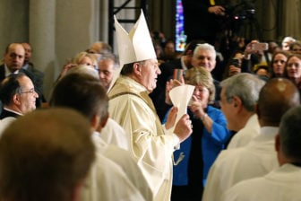 Archbishop Tobin walks up and down the aisle of the cathedral with the Vatican decree announcing he is the new Archbishop of Newark. Photo courtesy of Aristide Economopoulos via NJ Advance Media