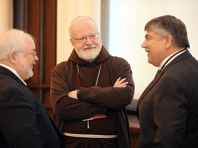 Cardinal SeanO'Malley, center, speaks with John Carr, director of the Initiative on Catholic Social Thought and Public Life at Georgetown University, left, and President of the AFL-CIO Richard Trumka, right, during the Erroneous Autonomy conference in Washington, D.C, on Jan. 10, 2017. Photo courtesy of The Catholic University of America/Dana Rene Bowler.