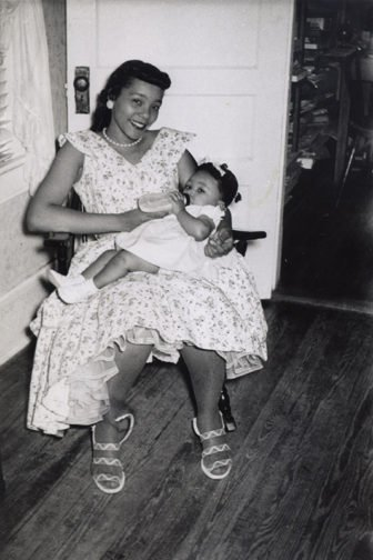 Coretta Scott King holds daughter Yolanda Denise King, the first of her and Martin's four children, in the parsonage of Dexter Avenue Baptist Church in Montgomery, Alabama, in 1956. Photo courtesy of The Estate of Coretta Scott King