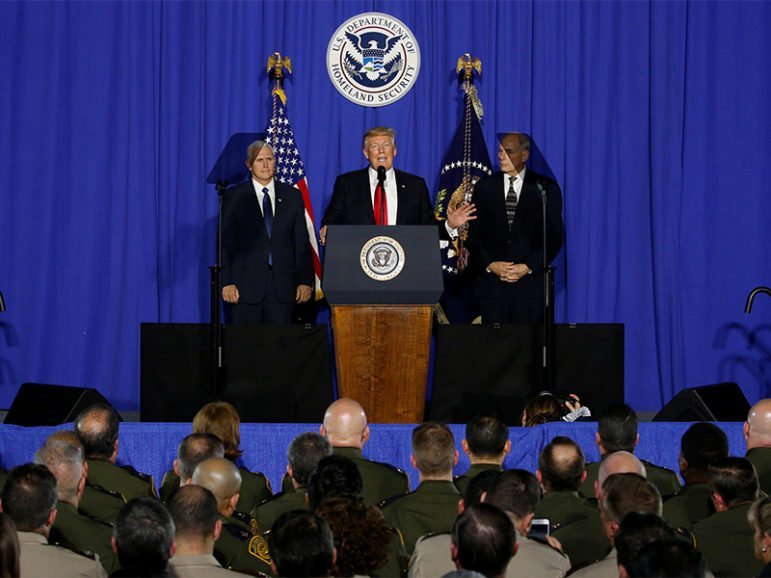 President Trump, center, flanked by Vice President Mike Pence, left, and Homeland Security Secretary John Kelly, delivers remarks at Homeland Security headquarters in Washington, D.C., on Jan. 25, 2017. Photo courtesy of Reuters/Jonathan Ernst