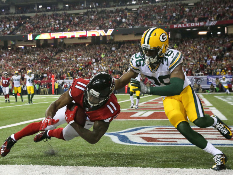 Atlanta Falcons wide receiver Julio Jones, left, scores a touchdown ahead of Green Bay Packers cornerback LaDarius Gunter during the second quarter in the 2017 NFC Championship Game at the Georgia Dome in Atlanta, GA, on Jan. 22, 2017. Photo courtesy of USA TODAY Sports/Jason Getz