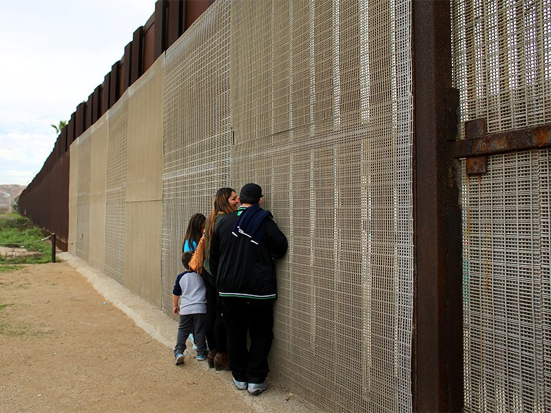Families separated by the two countries chat along the U.S.-Mexico border fence at Border Field State Park, Calif., on Nov. 19, 2016. Photo courtesy of Reuters/Mike Blake *Editors: This photo may only be republished with RNS-HOFFMEIER-OPED, originally published on Jan. 10, 2017.
