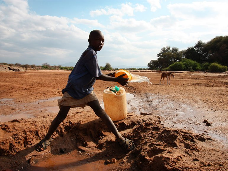 A child gathers water from a riverbed near Isiolo, Kenya, on July 30, 2013. Photo courtesy of EU/ECHO/Martin Karimi