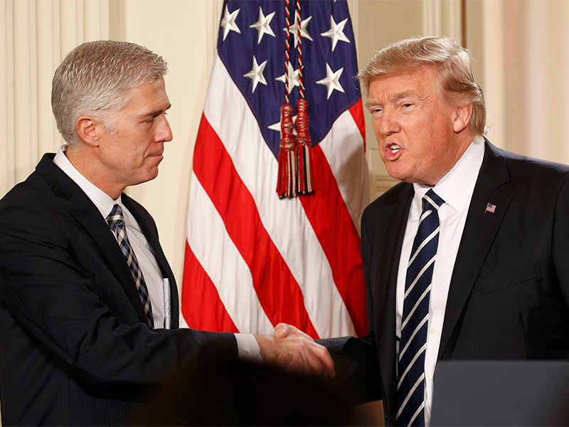 U.S. President Donald Trump shakes hands with Neil Gorsuch, left, after nominating him to be an associate justice of the U.S. Supreme Court at the White House in Washington, D.C., on Jan. 31, 2017. Photo courtesy of Reuters/Kevin Lamarque