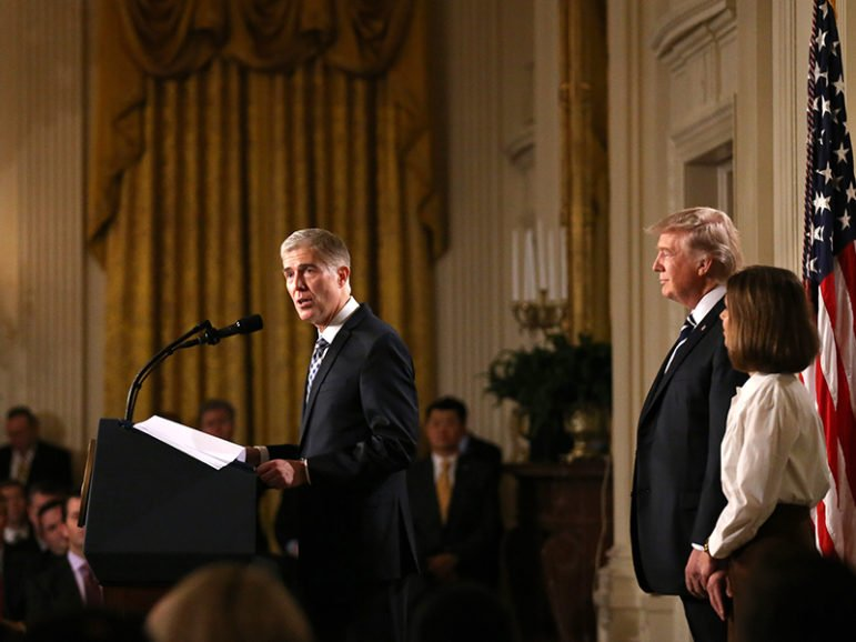 Judge Neil Gorsuch, left, speaks as President Trump stands with Gorsuch's wife, Marie Louise, after Trump nominated Gorsuch to be an associate justice of the Supreme Court on Jan. 31, 2017. Photo courtesy of Reuters/Carlos Barria