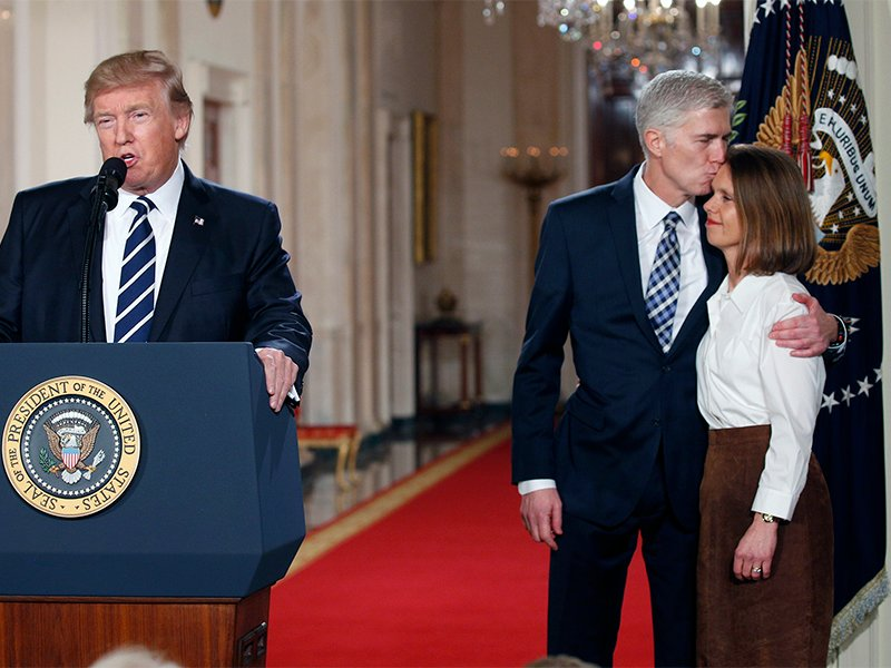 U.S. President Donald Trump announces his nomination of Neil Gorsuch to be an associate justice of the U.S. Supreme Court as Gorsuch, right kisses with his wife Marie Louise at the White House in Washington, D.C., on Jan. 31, 2017. Photo courtesy of Reuters/Kevin Lamarque