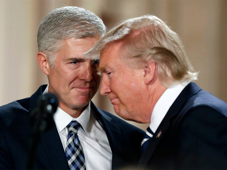 President Trump, right, and Neil Gorsuch smile as Trump nominates Gorsuch to be an associate justice of the U.S. Supreme Court at the White House in Washington, D.C., on Jan. 31, 2017. Photo by Kevin Lamarque/Reuters