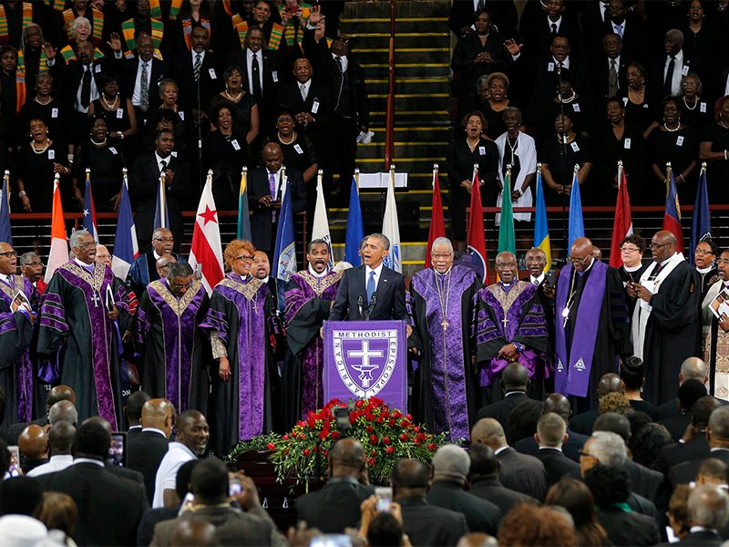 "President Obama leads mourners in singing the song ""Amazing Grace"" as he delivers a eulogy in honor of the Rev. Clementa Pinckney during funeral services for Pinckney in Charleston, S.C., on June 26, 2015. Pinckney was one of nine victims of the mass shooting at Emanuel African Methodist Episcopal Church. Photo courtesy of Reuters/Brian Snyder"