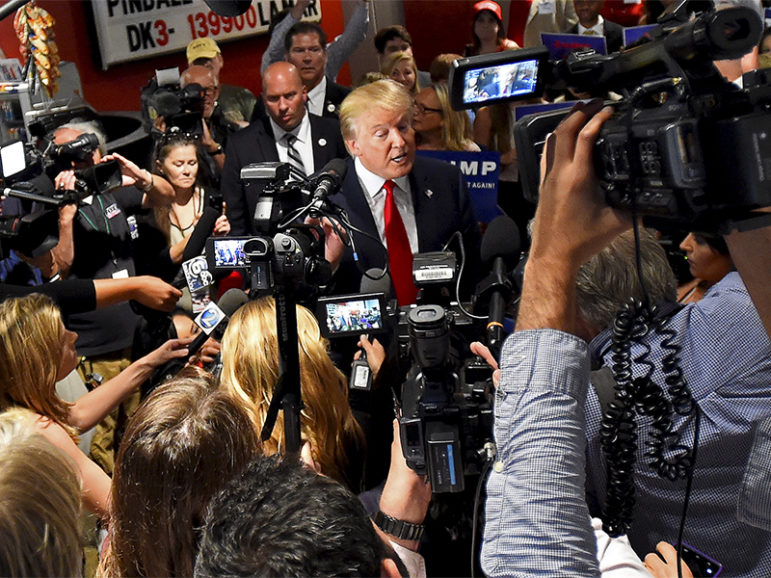 Republican presidential candidate Donald Trump speaks to the media during the National Federation of Republican Assemblies at Rocketown in Nashville, Tenn., on Aug. 29, 2015.  Photo courtesy of Reuters/Harrison McClary
