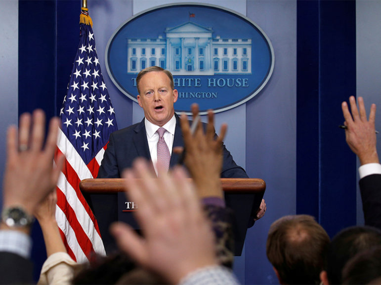 White House spokesman Sean Spicer holds a press briefing at the White House in Washington, D.C., on Jan. 23, 2017. Photo courtesy of Reuters/Kevin Lamarque