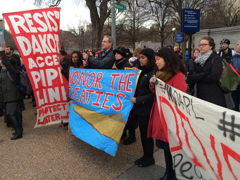 Acitivists who oppose the Dakota Access Pipeline protest outside the White House on Jan. 24, 2017, after President Trump's executive orders earlier in the day to continue construction. RNS photo by Jerome Socolovsky