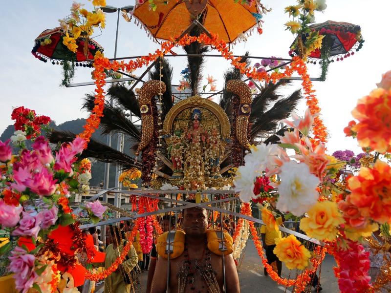 A Hindu devotee carries a Kavadi
