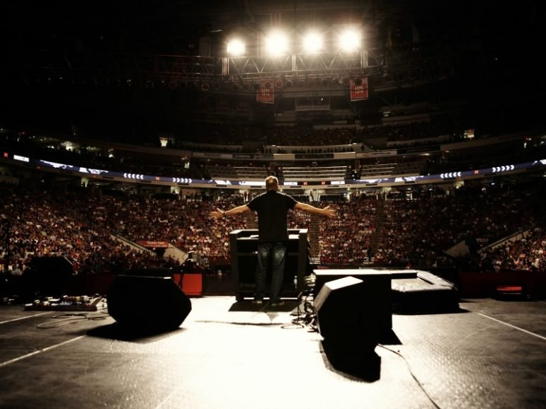 Greg Laurie preaches at a Harvest event. Photo courtesy of A. Larry Ross Communications