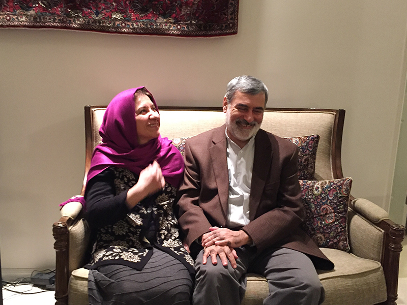 "Zahra ""Nikoo"" Roodi and her husband Mohsen Kadivar talk in their Chapel Hill, N.C., home late Feb. 16, 2017. RNS photo by Yonat Shimron."