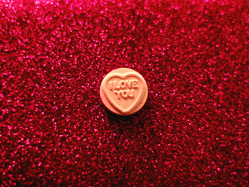 Heart-shaped candies with written messages. Photo courtesy of Creative Commons/Shandi-lee Cox