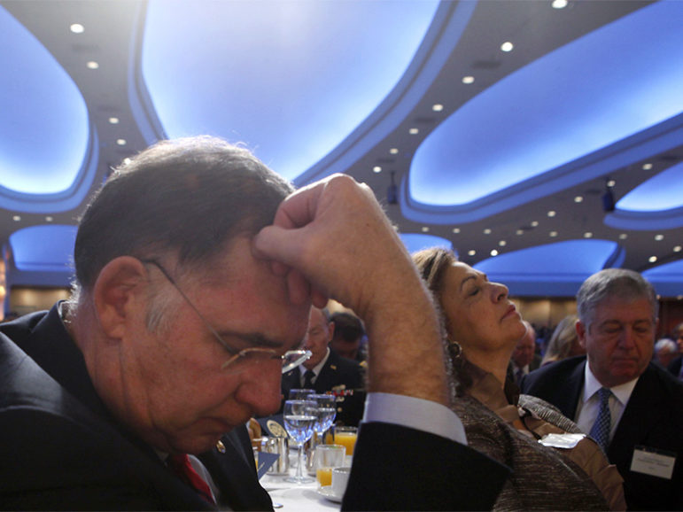Audience members pray at the 60th annual National Prayer Breakfast at the Washington Hilton hotel in Washington, D.C., on Feb. 2, 2012.   Photo courtesy of Reuters/Larry Downing