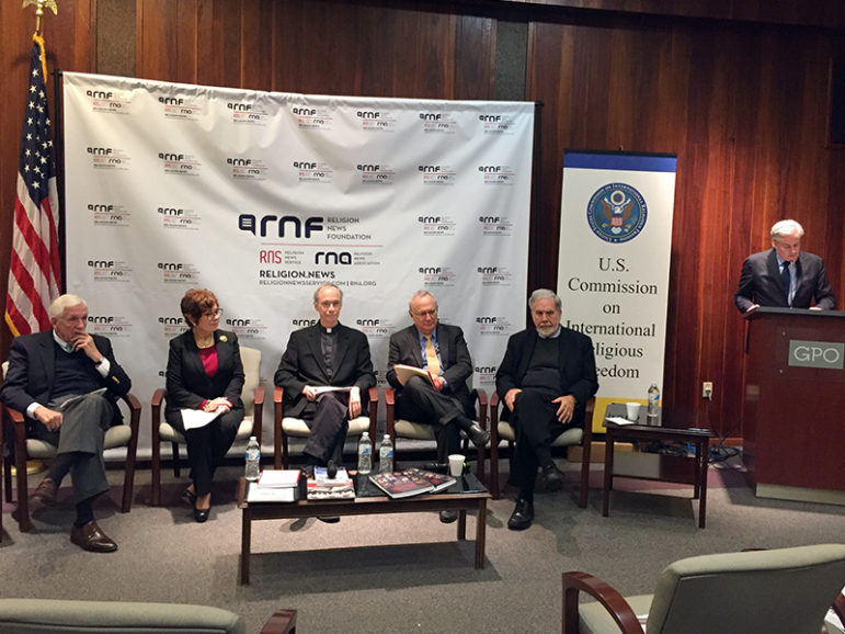"""Thomas Gallagher, far right, begins the panel discussion """"Tolerance: A Key to Religious Freedom"""" at the U.S. Commission on International Religious Freedom in Washington, D.C., on Feb. 9, 2017. RNS photo by Cathy Lynn Grossman"""
