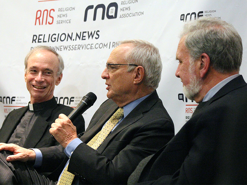 "Rev. Thomas J. Reese, left, reacts as Rabbi David Saperstein speaks with Dr. John Sexton looking on during the panel discussion ""Tolerance: A Key to Religious Freedom"" on Feb. 9, 2017. RNS photo by Adelle M. Banks"