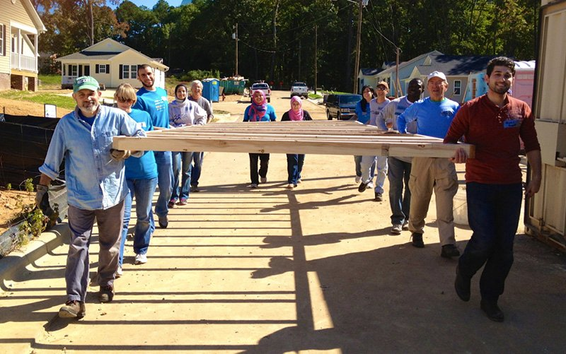 Yusor Abu-Salha, fourth from left, participated in Habitat for Humanity's 2013-14 Interfaith Build in Apex, N.C. Photo courtesy of Renee Revaz